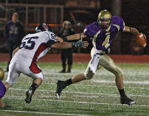 Roman Catholic quarterback Joseph Fuoco (right) is chased by Cardinal O'Hara's Chris Nolan in last week's 21-14 loss. Fuoco will try to rebound against Father Judge tomorrow.