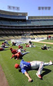 Pedro Feliz (foreground) and his Phillies teammates stretch before batting practice at Dodger Stadium in Los Angeles.