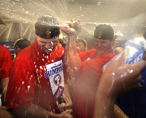Phillies players enjoy a champagne shower after Wednesday's victory.