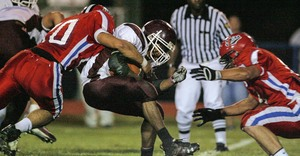 Abington's Julien Ireland gets tackled by Neshaminy's defense. Abington won a playoff game as a No. 16 seed two years ago.