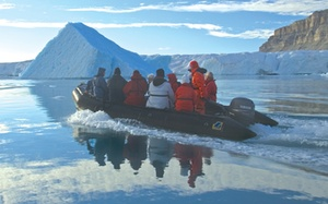 Bundle up! In a Zodiac boat in the high Arctic, cruisers venture out near Baffin Island.