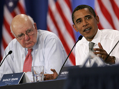 Paul Volcker (left)