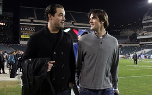 Pat Burrell and Cole Hamels talk over their strategy for last night´s coin toss at Lincoln Financial Field. OK, not really.