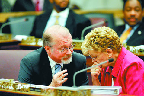 City Councilman William K. Greenlee, who is cosponsor of a bill that would make it harder to fraudulently obtain property deeds, confers with Councilwoman Joan L. Krajewski. (DAVID SWANSON / Staff Photographer)