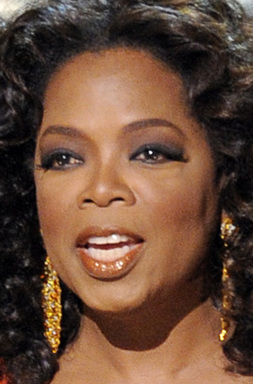 Oprah Winfrey looking gorgeous with a curly look.
