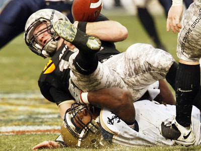Army´s quarterback Chip Bowden, top, is sacked by Navy´s Travis Sudderth and loses his grip on the ball during the first half of today´s 109th Army-Navy football game at Lincoln Financial Field. Navy won, 34-0. (AP Photo/Tom Mihalek)