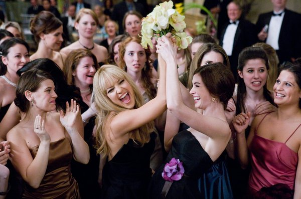 The usually appealing Kate Hudson (left) and Anne Hathaway are embarrassed by the film's orgy of conspicuous consumption.