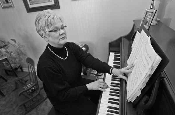 Carmel Kropp, cantor at the Cathedral Basilica of Ss. Peter and Paul, practices her liturgical music at her home in Exton.