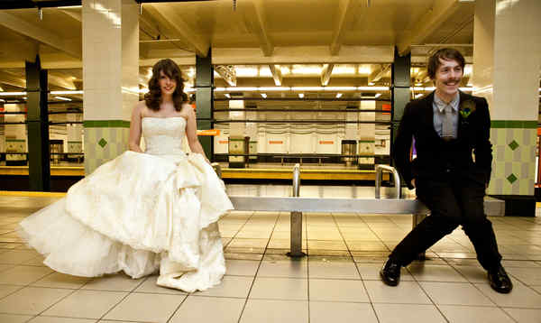 """With echoes of the final scene of """"The Graduate,"""" Leann Greto and Matthew Ashby, SEPTA lovers both, pose for their official wedding photos at the Walnut-Locust subway stop."""