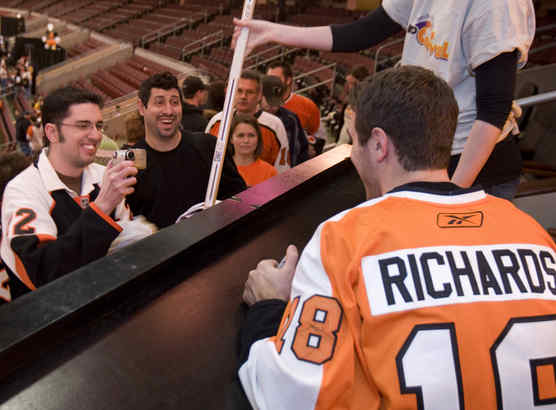 Flyers captain Mike Richards poses for fan Thomas McDonald at the 32nd annual Flyers Wives Fight for Lives Carnival yesterday at the Wachovia Center.