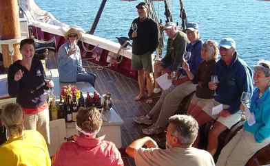 Jane Barnes leads a wine tasting aboard the Stephen Taber tall-masted sailing ship off the coast of Maine.