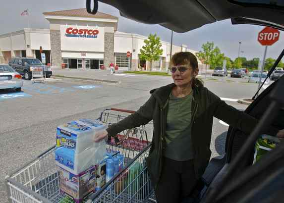 "Outside Costco in Mount Laurel, Laurie Ianucci packs her car with bulk items for ""The Tender,"" a social-setting, adult day-care center for frail seniors and people with Alzheimer´s."