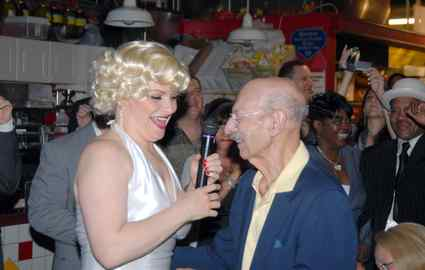 "Dressed as Marilyn Monroe, Marion ""Tootsie"" D´Ambrosio joins Harry Ochs at Reading Terminal Market film festivities in May."