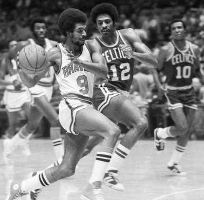 With the Buffalo Braves in 1973, Randy Smith (9) flashes past Don Chaney of the Celtics. He played for 13 years in the NBA and was in 906 straight games from 1972 to 1983.