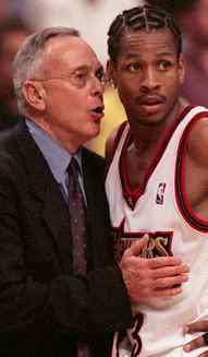 Sixers coach Larry Brown and Allen Iverson confer during a 1999 game. Could they be reunited in Charlotte?