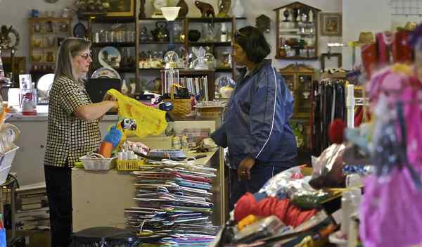Owner Barbara DeNero assists Julie Singh at Treasure Chest Thrift, in Berlin, Camden County.