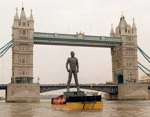 OK, so the statue of Michael Jackson, seen here being pulled up the River Thames in London in a 1995 photo, didn´t prove to be a big tourist draw. But the London Eye Ferris wheel is a winner and could inspire a Philly attraction, says Philly Mag. (AP Photo)