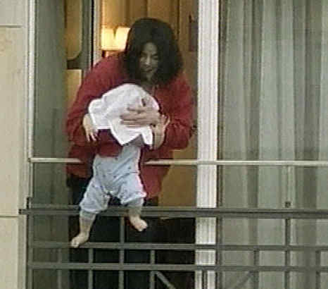 Michael Jackson holds his son, Prince Michael II, for fans to see on a Berlin hotel balcony in an incident that drew criticism.