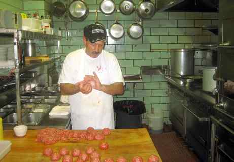 Basil DeLuca at work on his specialty, meatballs of consistent character. He fries them, 16 at a time, for a browned crust, tender interior; then, into the gravy. Villa di Roma, in the Italian Market since 1963, is opening a new production kitchen a couple of doors down.