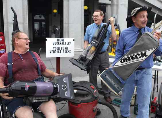 Gene Stilp (right) and pals protest former State Sen. Vincent J. Fumo´s 55-month jail term by collecting vacuum cleaners in Harrisburg last month.