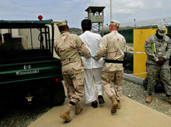 A prisoner is escorted at the U.S. prison in Gantanamo Bay, Cuba. (BRENNAN LINSLEY / Associated Press, File)