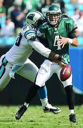 Eagles quarterback Kevin Kolb is stripped of the football by the Panthers´ Julius Peppers in the fourth quarter.