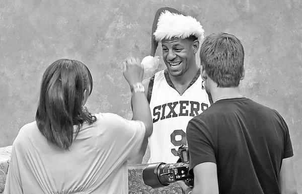 It´s beginning to look a lot like . . . Sixers season, as Andre Iguodala gets ready for Christmas promo.