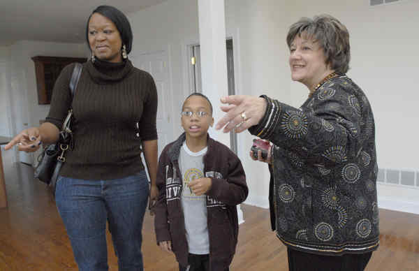 Buyers report that there are fewer sellers, but that they are more eager to negotiate. Pascale Phaeton and her son, Julius Lipscomb, were looking in Chadds Ford with Realtor Pam Gabriel.