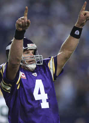 Vikings QB Brett Favre celebrates one of his three touchdown passes against Green Bay on Monday night.