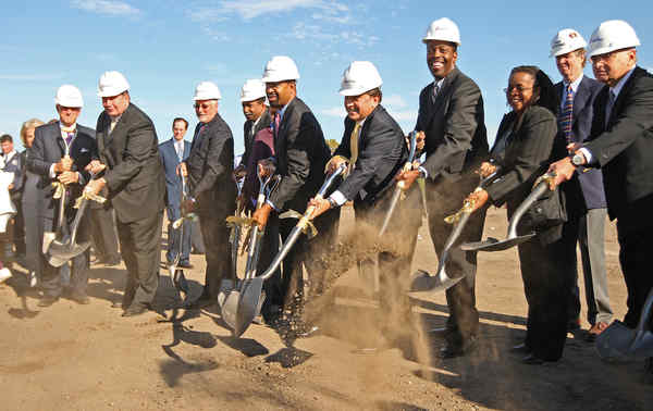 City pols, including Mayor Nutter (above, center) break ground for SugarHouse casino within earshot of about 50 anti-casino protesters (right).