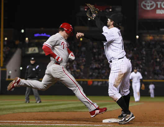 "Chase Utley of the Phillies reaches base safely after the ball struck him in the batter´s box.""That´s not why we got beat,"" manager Jim Tracy said, citing his hurlers´ eight walks Sunday."