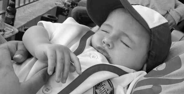 11-month-old Travis Hennessy of Mayfair rests up to be ready for this year´s World Series.