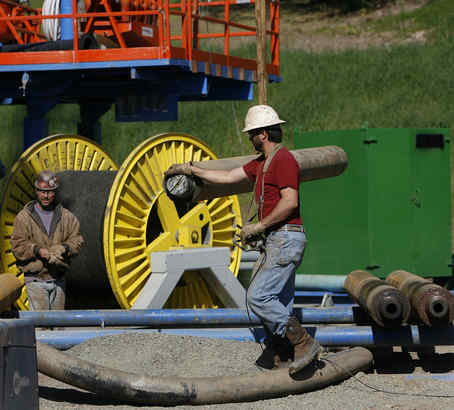 Doug Stough steadies things as he and Joe Rivera work to get a bore hole going.<br />