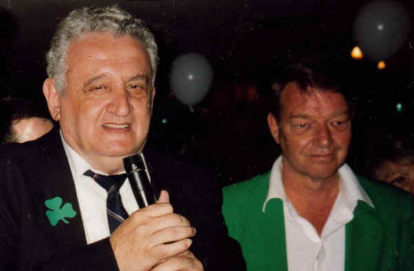 Lifetime Phils fan and longtime team employee Jerry Politano (left) sings with Harry Kalas at a Clearwater, Fla. karaoke bar.