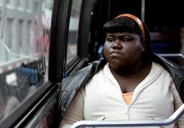 """Precious"" stars Gabourey Sidibe in the title role, an obese, brutalized, illiterate teen who learns, with help, to read and write and reconnect."