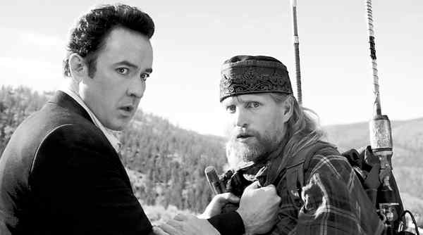 "John Cusack as a sci-fi novelist, Woody Harrelson as End-of-Days shock jock in ""2012,"" a preposterous and diverting 21/2-hour disaster flick."