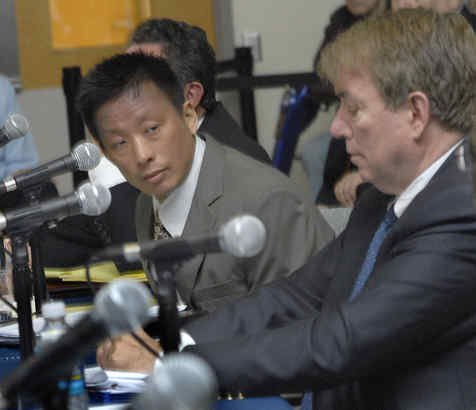 Gary Kao, the University of Pennsylvania radiation oncologist who directed the prostate program, appearingat a Senate hearing in June. At right is Gerald Cross of the Veterans Health Administration. (APRIL SAUL / Staff Photographer)