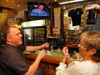 "New millionaire Sam Murray, left, is toasted after watching ""Who Wants to Be a Millionaire"" with his mother, Antonia Ojeda Flaherty. Murray had invited friends and family to watch the program this afternoon at Paddy´s Old City Pub. (Michael S. Wirtz / Staff Photographer)"
