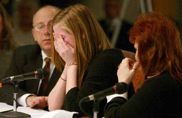 An unidentified juvenile cries as she testifies in Wilkes-Barre about her experiences with former Luzerne County Judge Mark A. Ciavarella, who is awaiting trial on racketeering charges. (Associated Press photo)