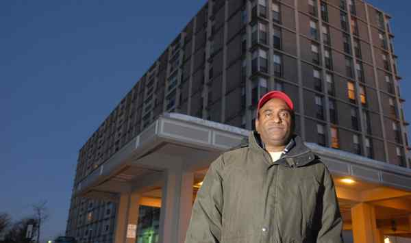 A resident of the Marquis Apartments, Anjan Veeramalla, in front of the King of Prussia complex. Advertised as a luxury property, it has twice come to the brink of being declared uninhabitable.