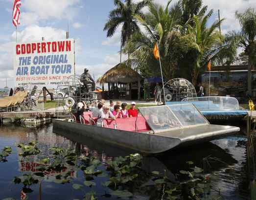Visitors depart on an airboat tour in Coopertown. Jesse Kennon´s family has been conducting them since 1945; 50,000 tourists a year take the ride.