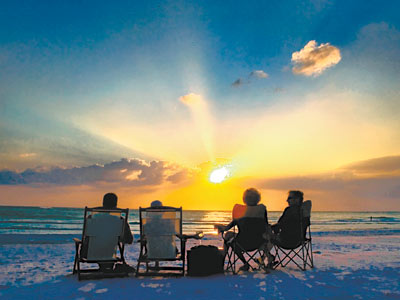 On Siesta Key, a spectacular sunset can be even more special with a tropical cocktail in hand and one's feet planted in the soft quartz sand. The beach rates high even with Dr. Beach. (Sarasota Convention and Visitors Bureau)