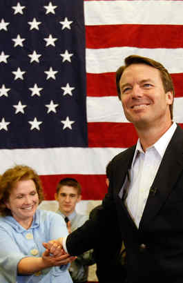 John Edwards (right) holds hands of wife, Elizabeth, before making a speech in Iowa on Jan. 1, 2008.