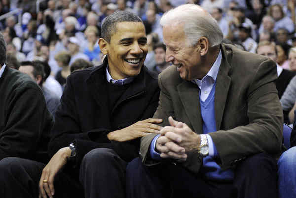 GAME FACES. President Obama and Vice President Joe Biden share a laugh while watching the Duke-Georgetown basketball game on Saturday in Washington. Georgetown won.