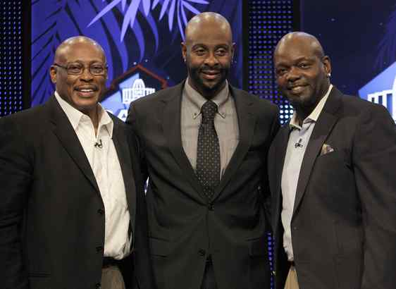 Floyd Little (left) joins first-ballot selections Jerry Rice (center) and Emmitt Smith after they all were elected to the Hall of Fame. Little waited three decades to make it.