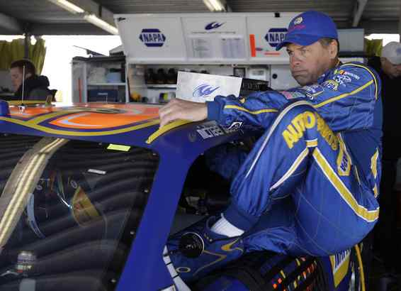 Michael Waltrip climbs into his car for practice yesterday.