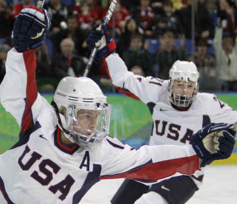 Jenny Potter (left) and Hilary Knight celebrate after Potter scored one of her three goals in Team USA´s 13-0 rout of Russia in women´s hockey. It was Potter´s second straight hat trick.