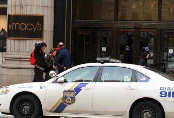 Police car guards the entrance to Macy´s in wake of Tuesday´s flash-mob rampage there.