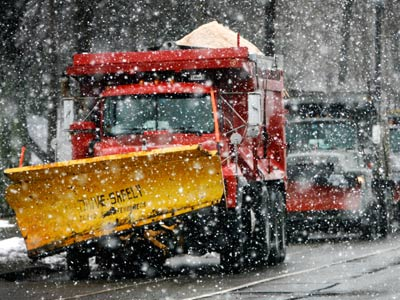 With salt in their beds, plow trucks sat this afternoon along Parkside Avenue near Belmont Avenue in the Parkside section of Philadelphia, waiting for the predicted heavy snow expected to blanket the area overnight. (Alejandro A. Alvarez / Staff Photogrpaher)