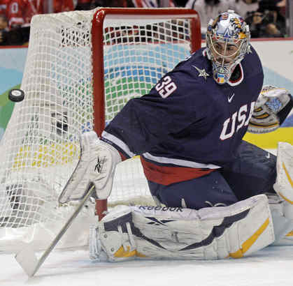 Ryan Miller makes a save against Canada on Sunday.